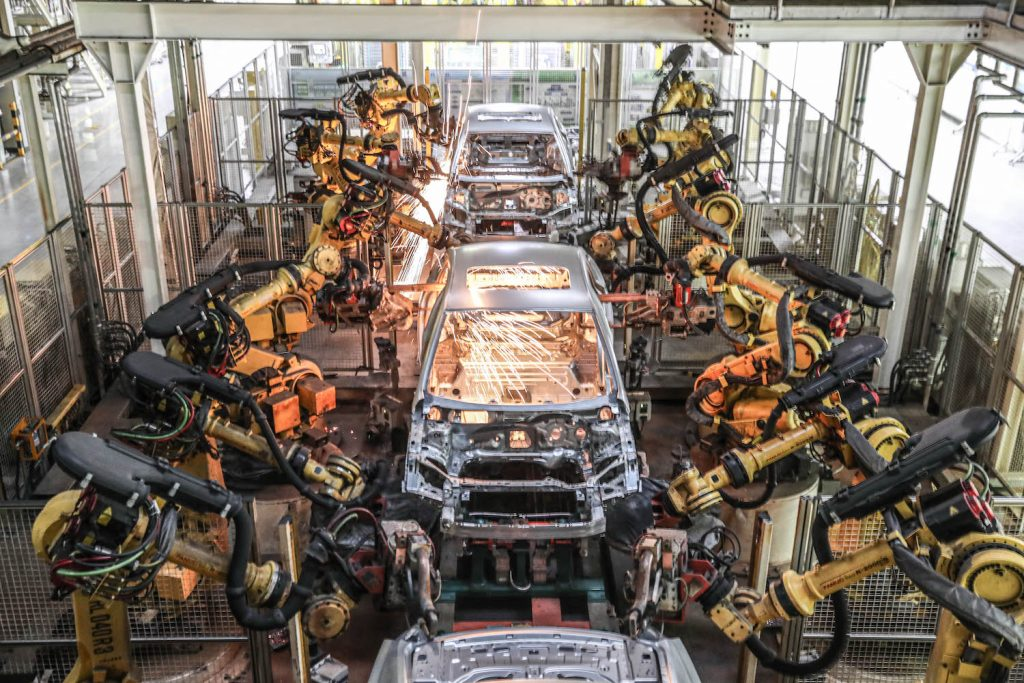 Robotic Arms Assembling GM Cars