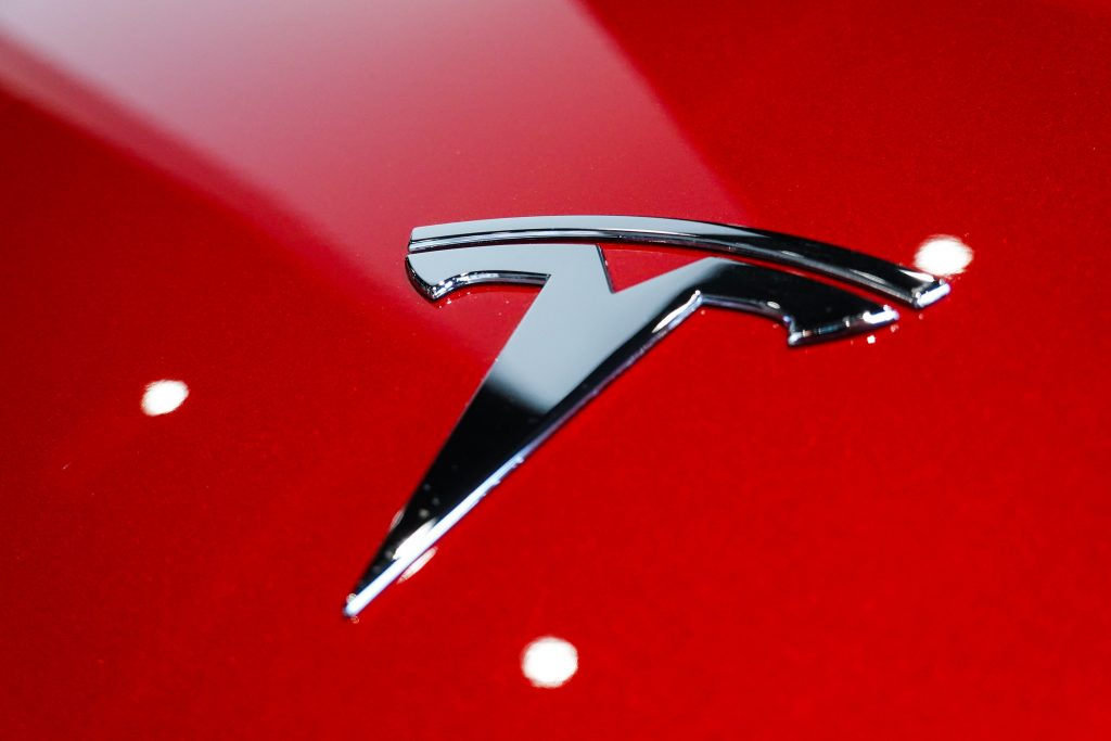 Tesla's logo on the hood of one of their cars