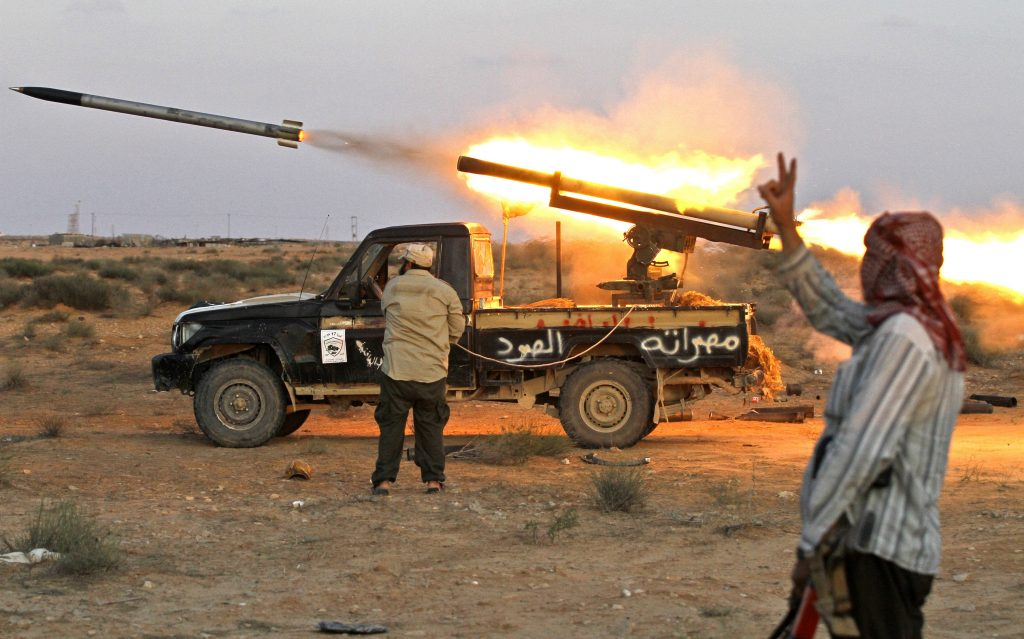 Fighters in the Mideast launch a Grad rocket off the back of a Toyota truck