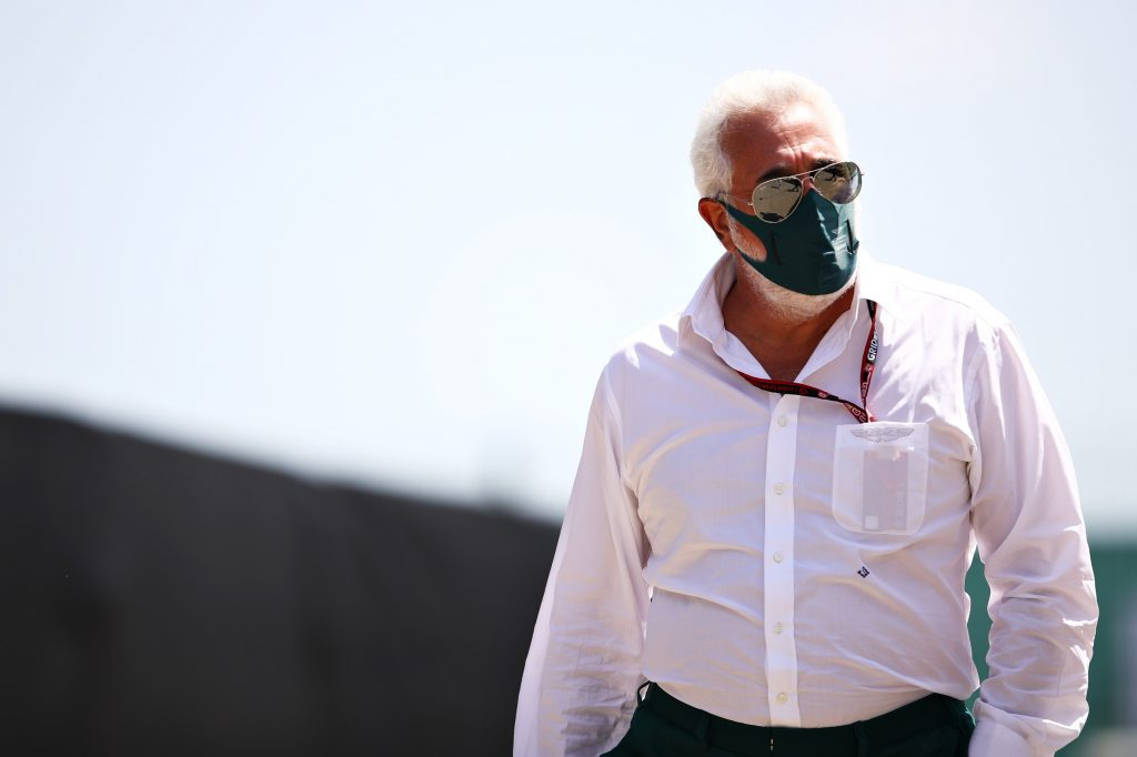 Aston Martin F1 team owner Lawrence Stroll walking in the paddock at Silverstone
