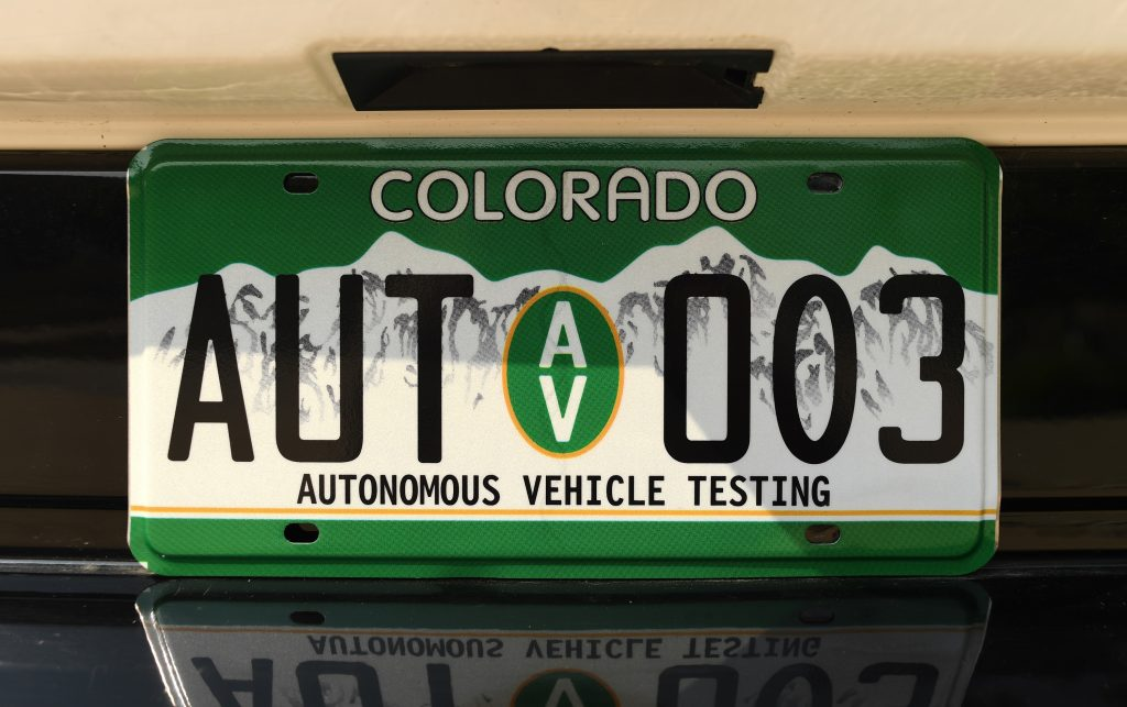 """A special Colorado license plate with the text """"autonomous vehicle testing"""""""