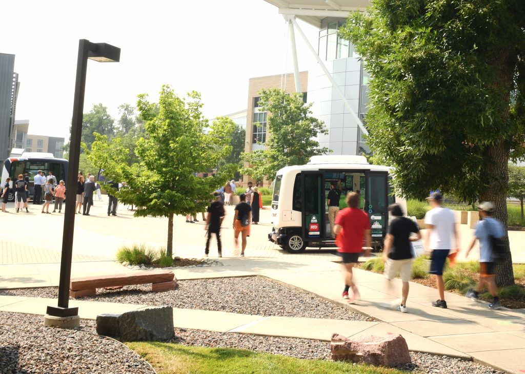 Students at the School of Mines board an AvCo autonomous vehicle