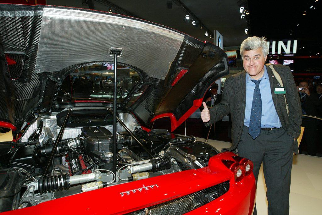 Jay Leno gives a read Ferrari Enzo a thumbs up at the Detroit auto show, so why doesn't Jay Leno own a single Ferrari?