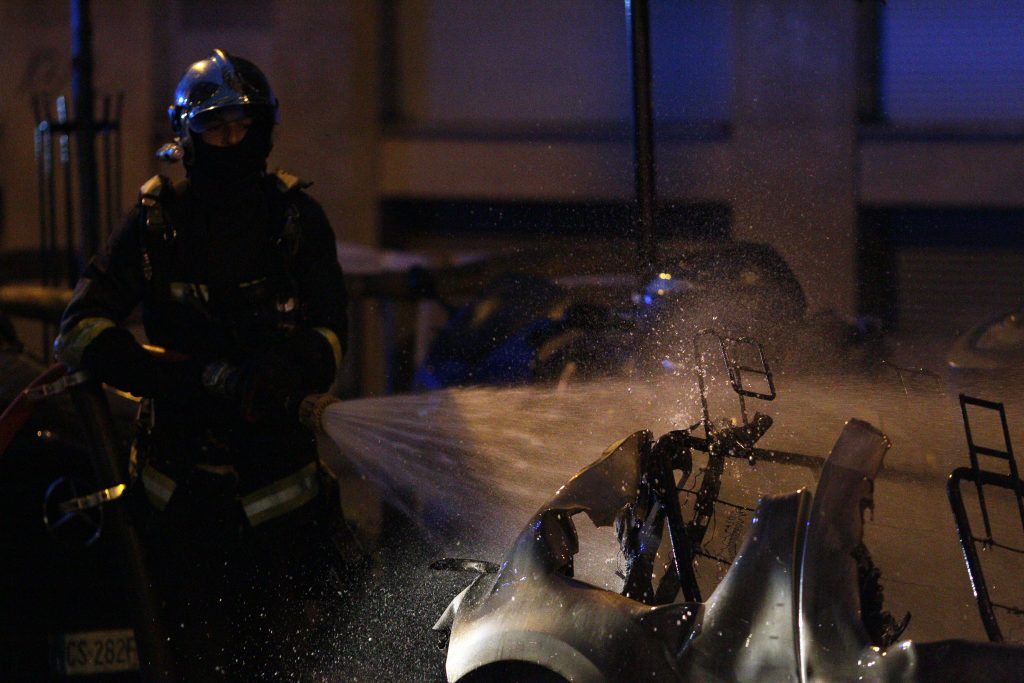 A firefighter puts out an electric vehicle battery fire in France