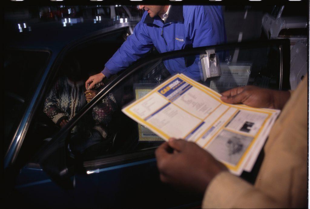 CarMax Salesman Handing Car Keys to Woman
