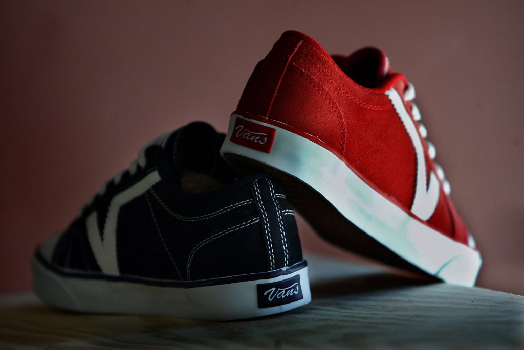 Two red and black Vans skate shoes