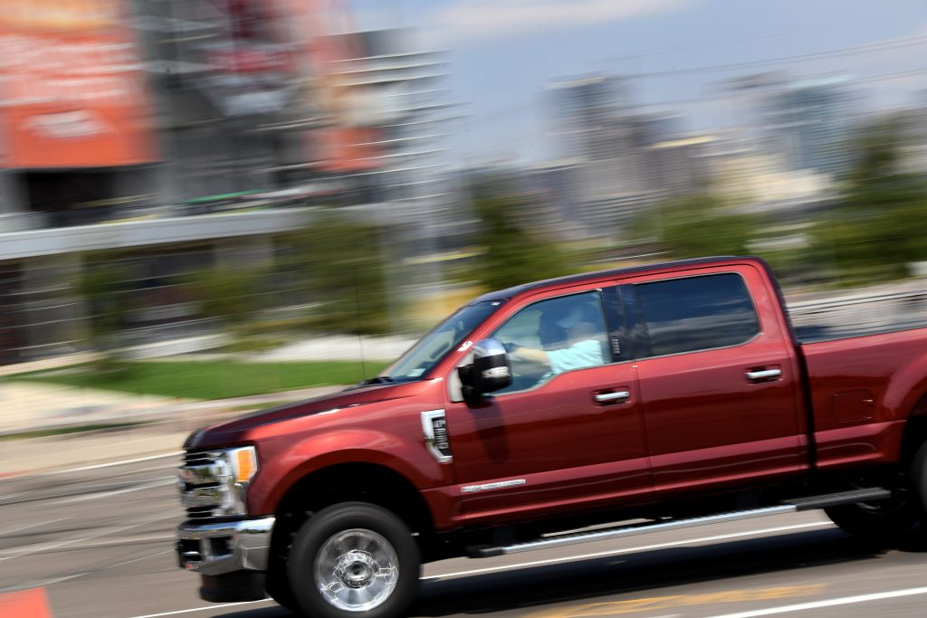 The 2021 Ford Super Duty pickup truck driving at speed