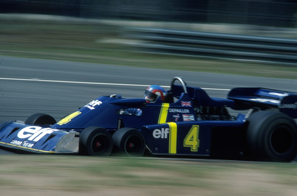 Patrick Depailler hoons the blue and yellow Elf P34 around Zolder in 1976