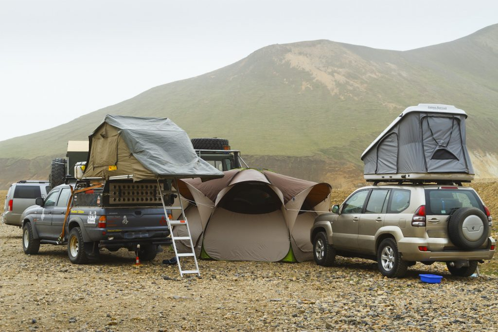 Overland Camping Shelter Options: Overlanders use both softshell and hardshell rooftop campers while exploring Landmannalaugar. Iceland. (Photo by: Mikel Bilbao/VW PICS/Universal Images Group via Getty Images)