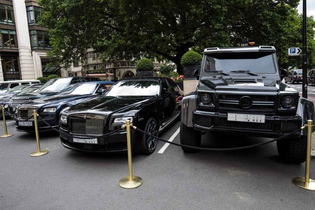 LONDON, ENGLAND - AUGUST 01: A row of cars including a Brabus (R) and two Rolls Royce sit parked outside The Dorchester hotel in Mayfair on August 1, 2017 in London, England. Each summer luxury supercars from the Arab states arrive in London and are often found parked outside the city's most exclusive hotels. (Photo by Jack Taylor/Getty Images). Read about the The Rise of The Supertruck: Brabus, Tesla, and Hummer Lead This New Exotic Truck Class