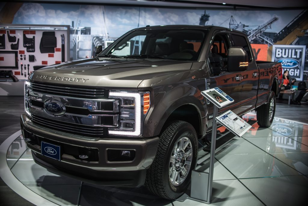 A Ford F-350 Super Duty truck on display at an indoor auto show