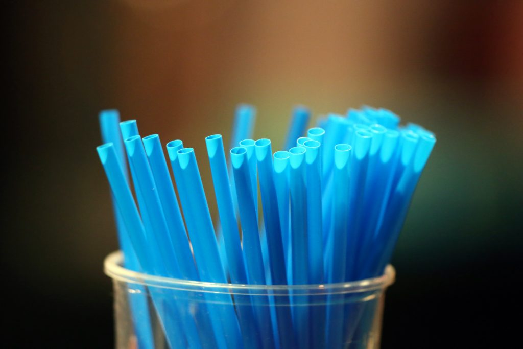 Blue straws in a glass.  France. (Photo by: Godong/Universal Images Group via Getty Images). Straws are one of our do it yourself car hacks.