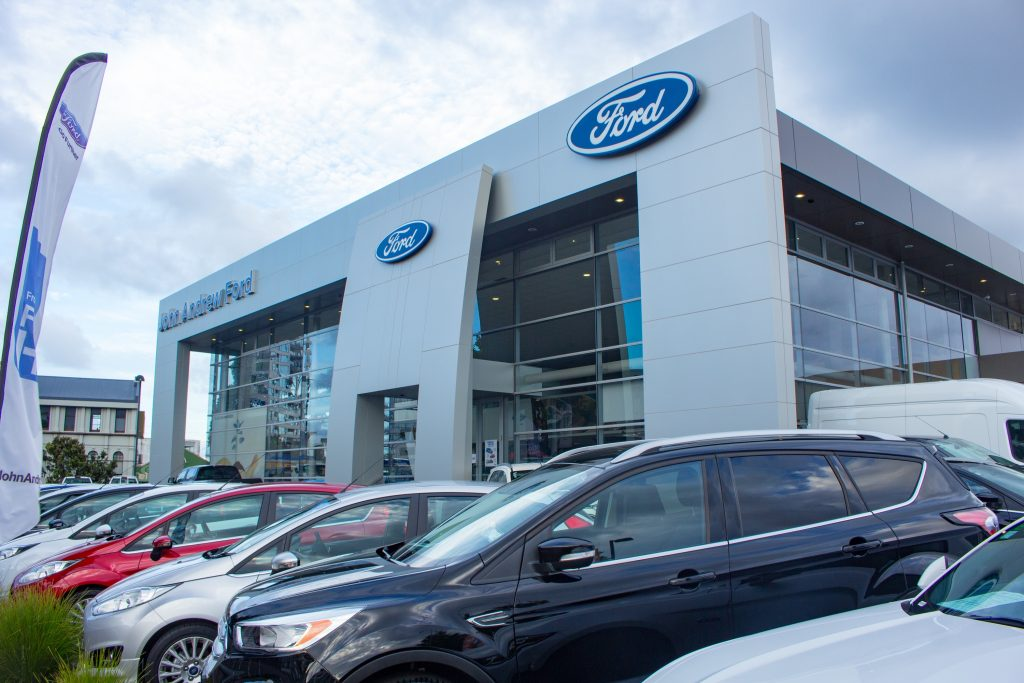 A Ford dealer with models lined up out front