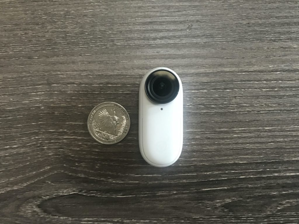 The size of the Insta360 Go 2 in relation to a quarter