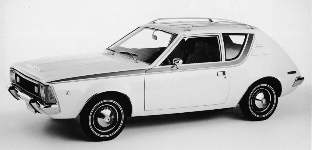 A white 1970 AMC Gremlin against a white background.