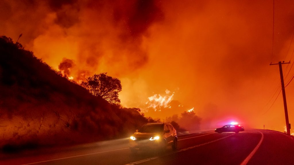 Cars escaping the Bond Fire near Silverado Canyon in Orange County