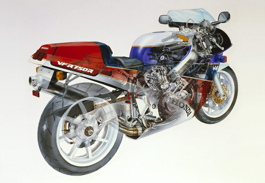The rear 3/4 view of a cutaway white-blue-and-red Honda RC30