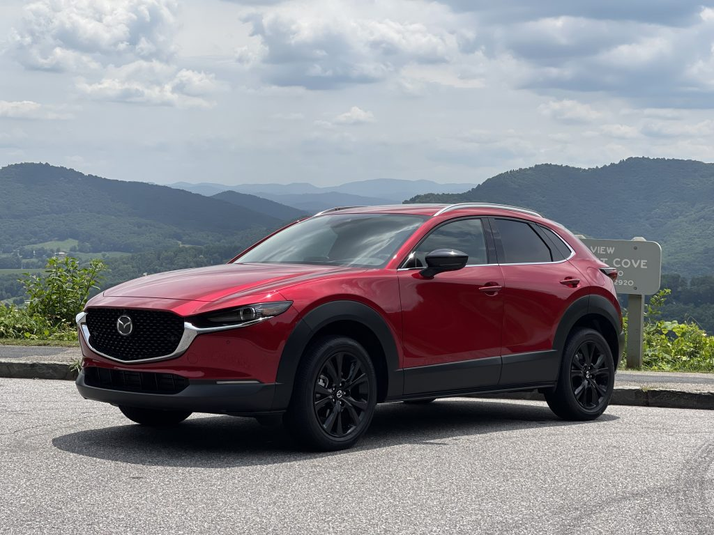 The 2021 Mazda CX-30 Turbo parked in front of a mountain view