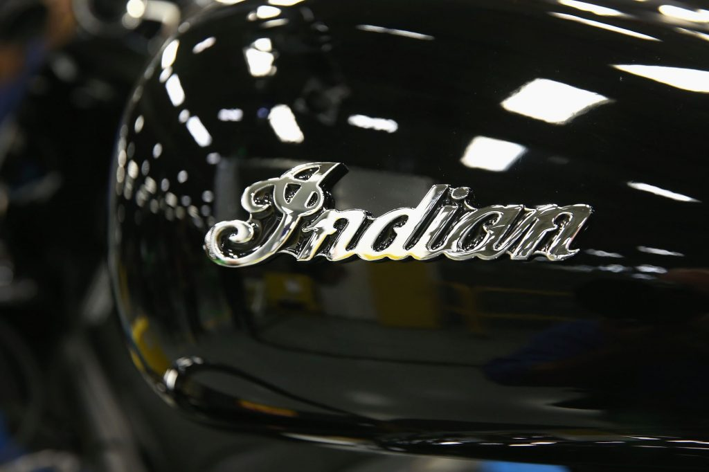 Indian Motorcycle's name written on a black motorcycle tank.