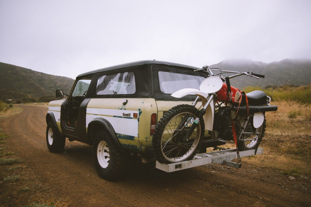 Scout II with a dirt bike mounted to the back