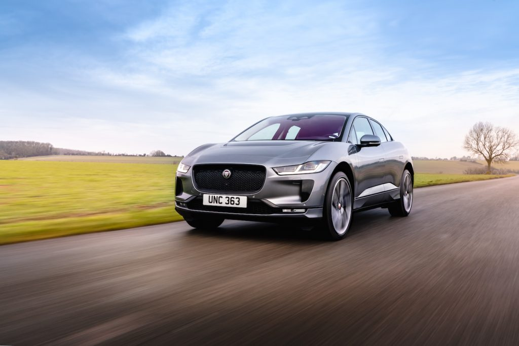 A silver Jaguar I-PACE driving, the Jaguar I-PACE is a new midsize SUV