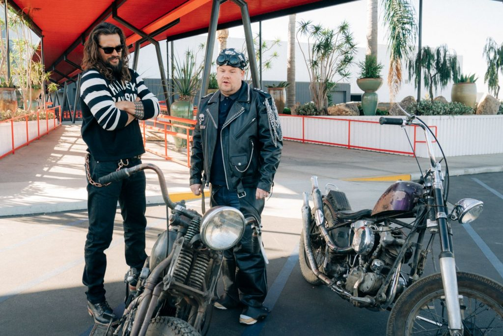 Jason Momoa and James Corden looking at a pair of motorcycles on 'The Late Show with James Corden'