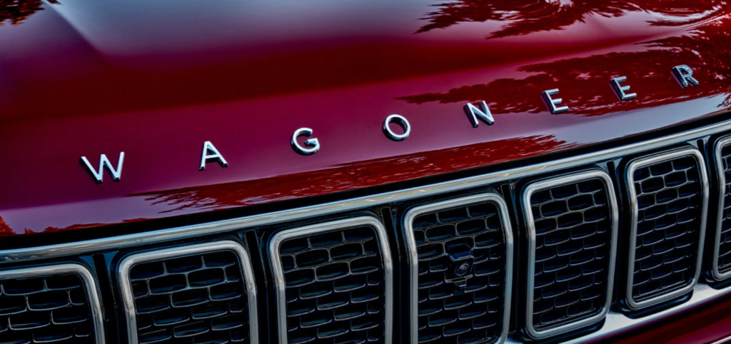 The Jeep Wagoneer and model lettering above the grille with a red paint color option