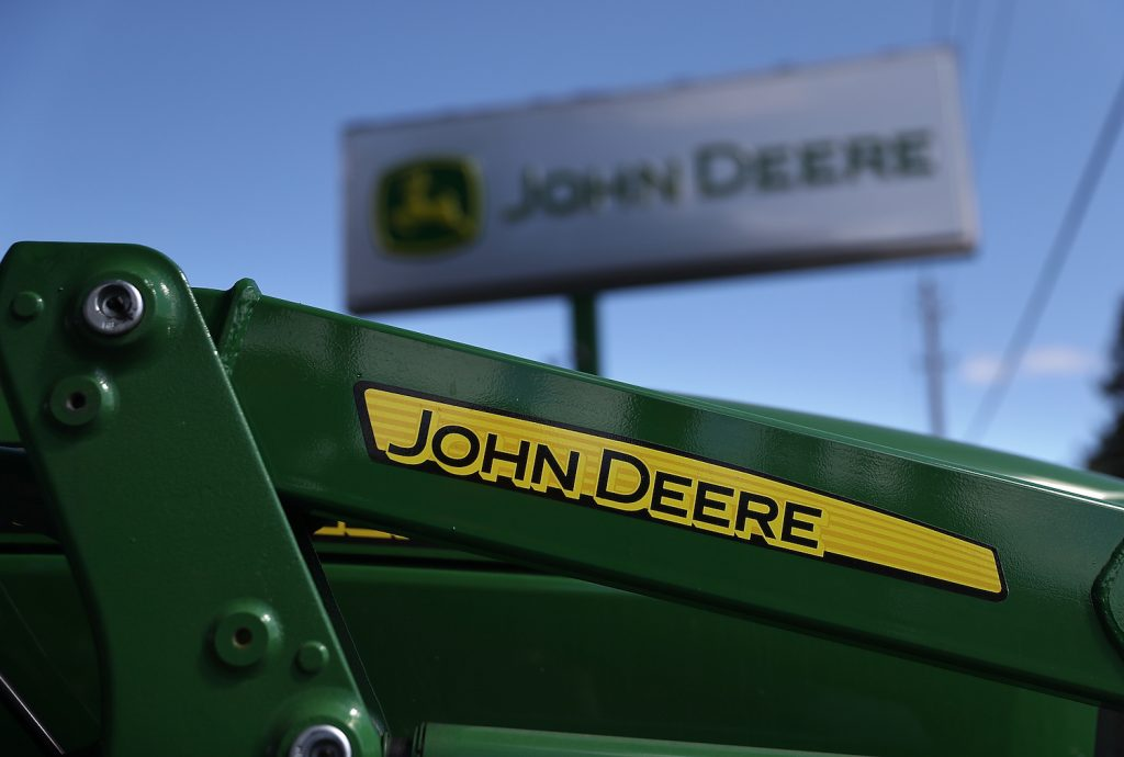 The John Deere logo on a tractor, John Deere makes some of the best zero-turn lawn mowers according to Consumer Reports
