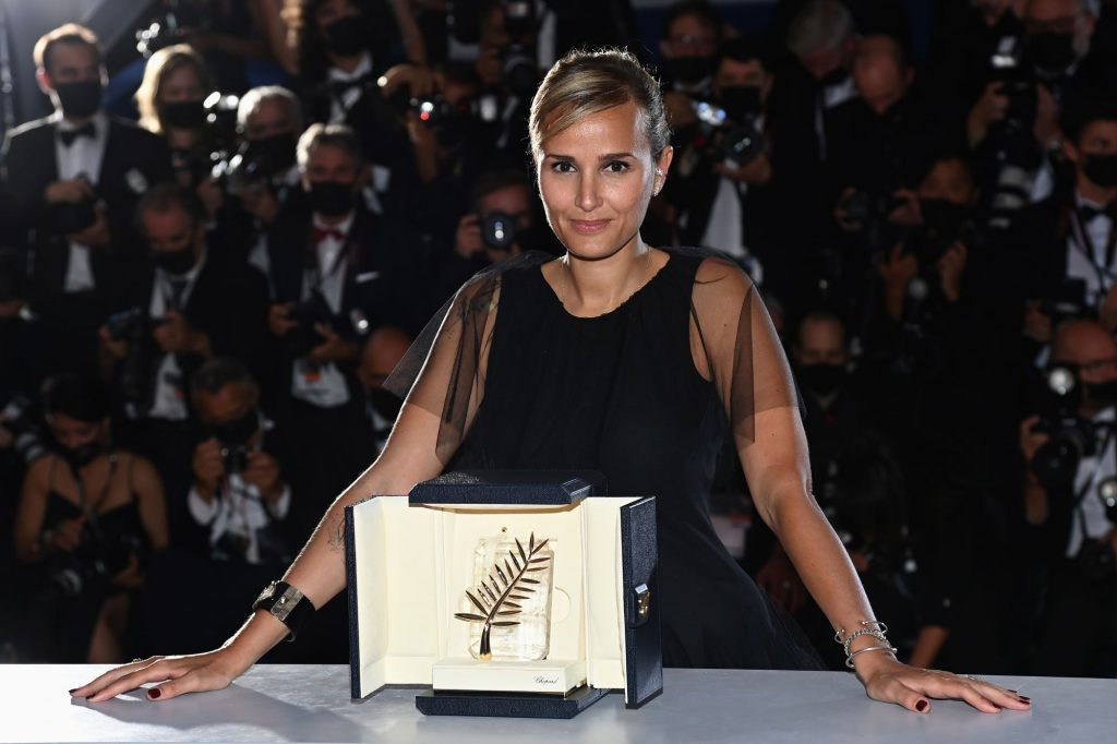 Julia Ducournau with the Palme d'Or 'Best Movie Award' for 'Titane' during the 74th annual Cannes Film Festival