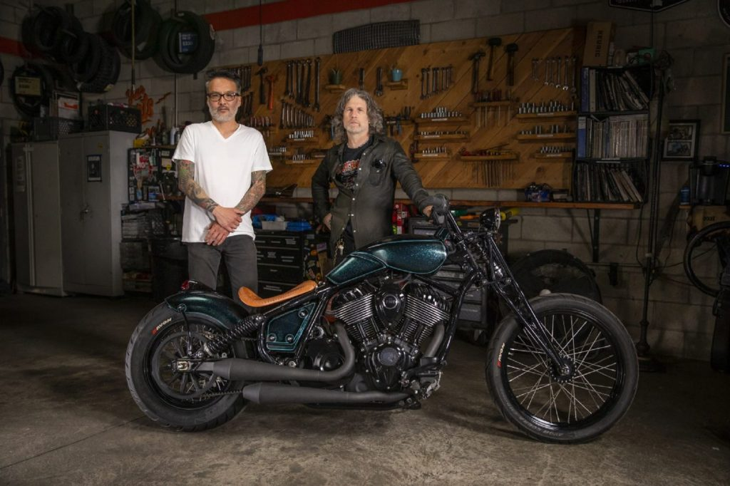 Keino Sasaki (left) and Paul Cox with their metallic-green custom 2022 Indian Chief in a garage