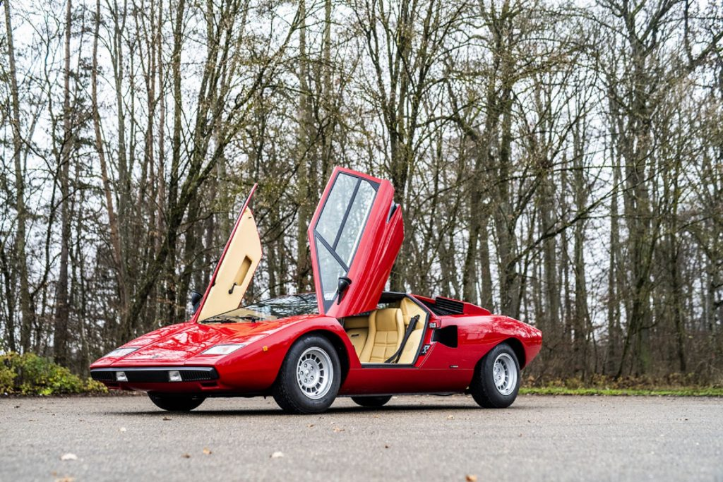 A red 1977 Lamborghini Countach LP400 with its doors raised