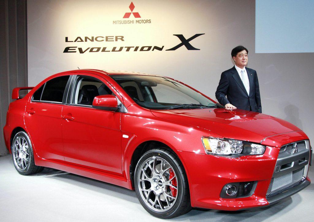a red Mitsubishi lancer evolution on display