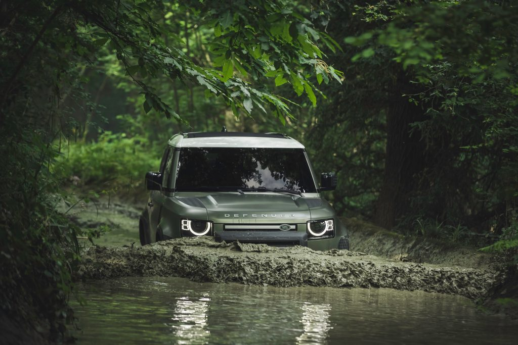 2021 Land Rover Defender 90 review takes the Defender half way underway as it fords a river