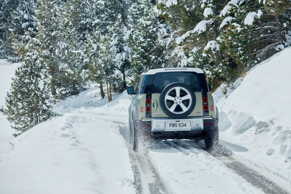 new Land Rover Defender driving through the snow