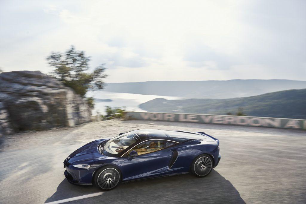 Mclaren's GT in blue on a twisty road in St Tropez