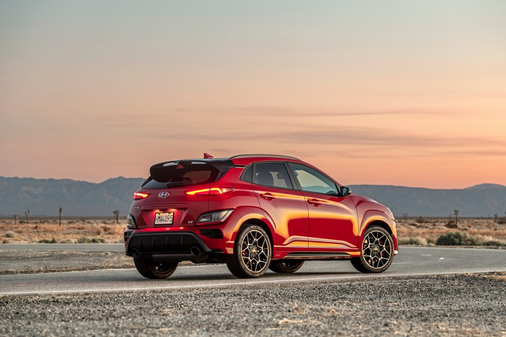 The rear end of a red Kona N at sunset