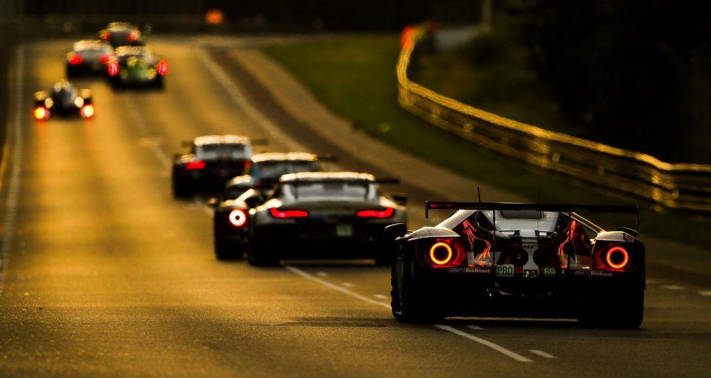 Sports cars driving down the Mulsanne Straight at Le Mans Circuit de la Sarthe