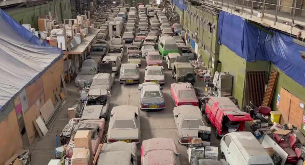 bird's eye view of massive collection of barn find vintage cars went up for auction in the U.K.