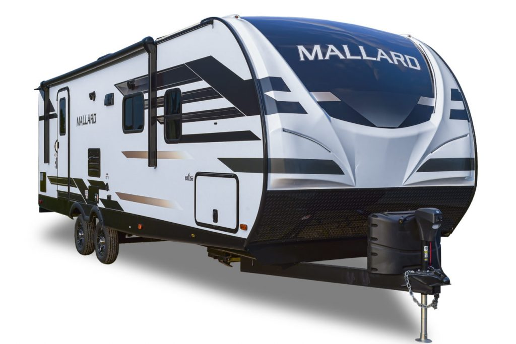 a front quarter view of the Mallard travel trailer in a press photo against a white backdrop