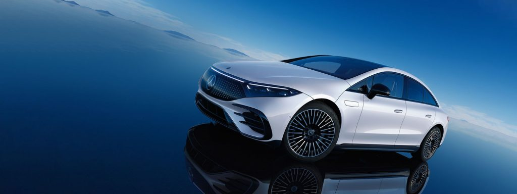 The 2022 Mercedes-Benz EQS model in white parked on a reflective surface