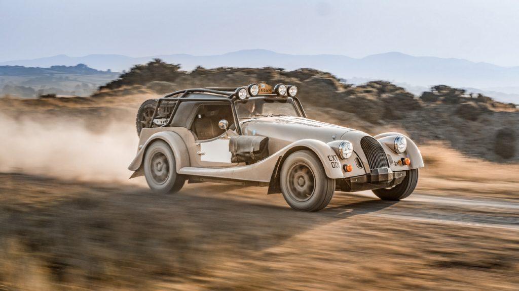 A tan Morgan Plus Four CX-T races through a dusty trail