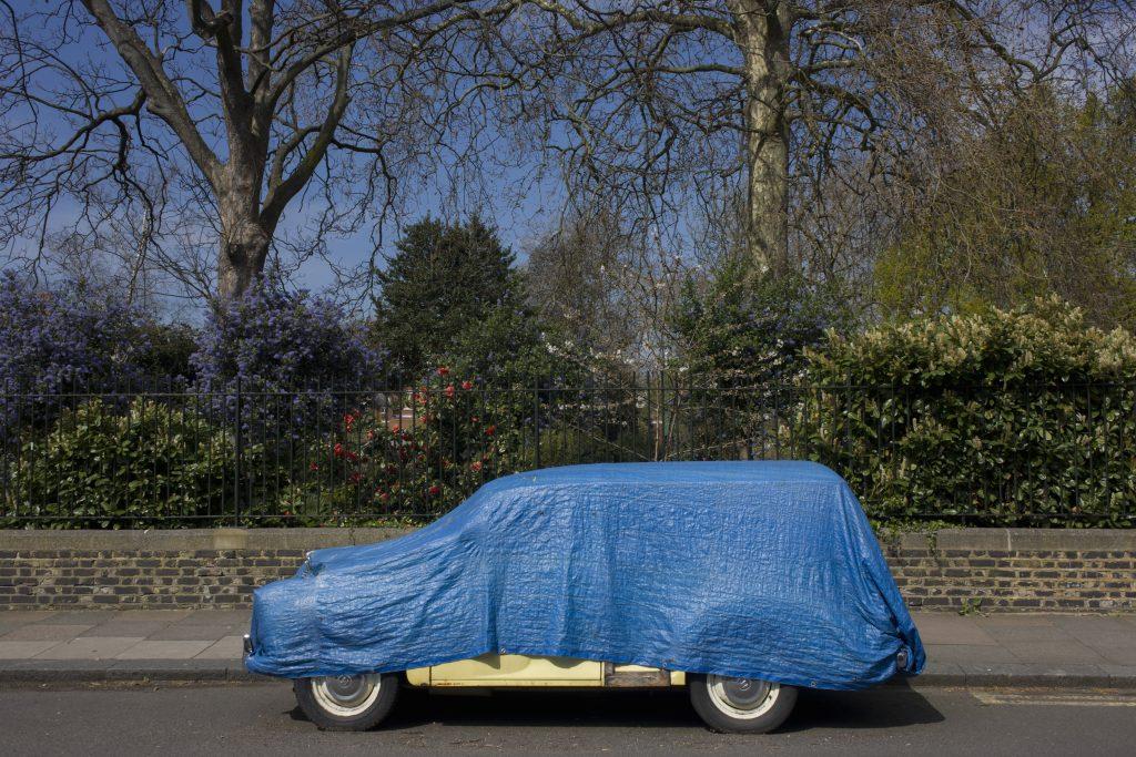Morris Minor Classic Car Covered By Tarp