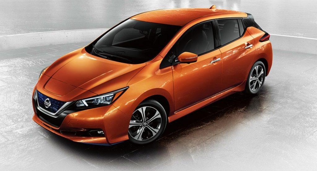 An orange Nissan Leaf.