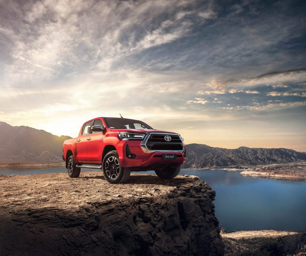 A 2021 Toyota Hilux sits on a cliffside