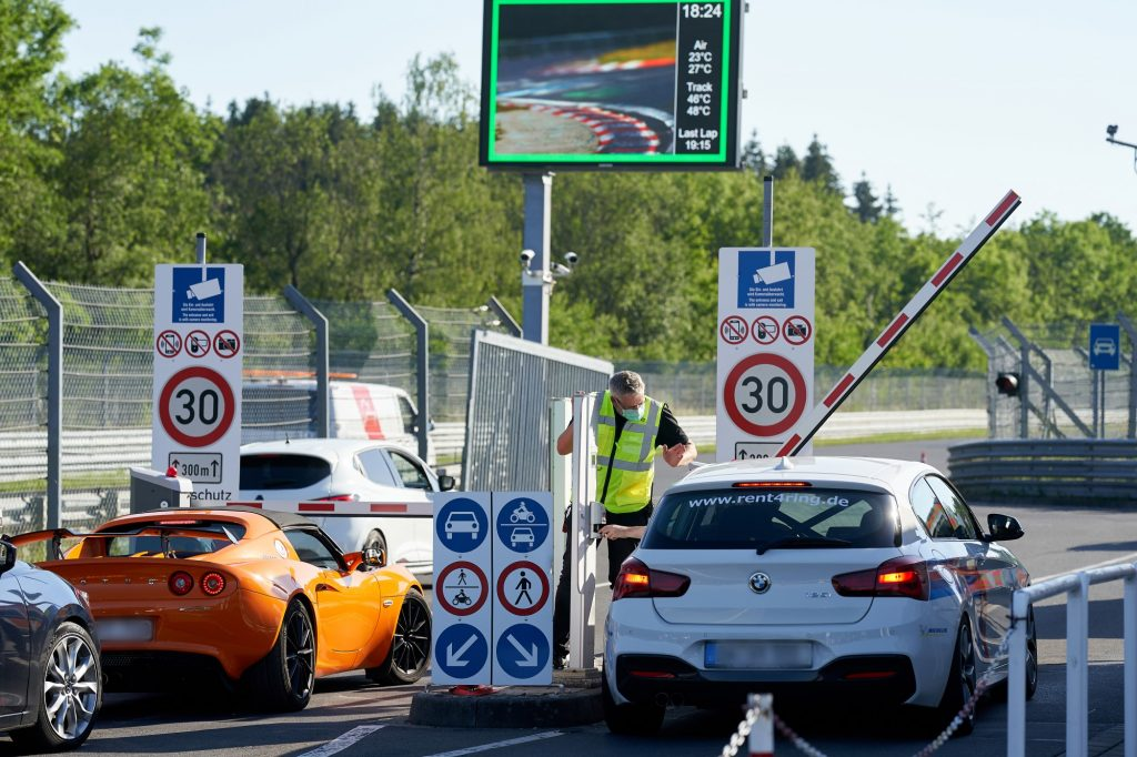 Tourist drivers enter the toll gate at Nürburgring Nordschleife race track