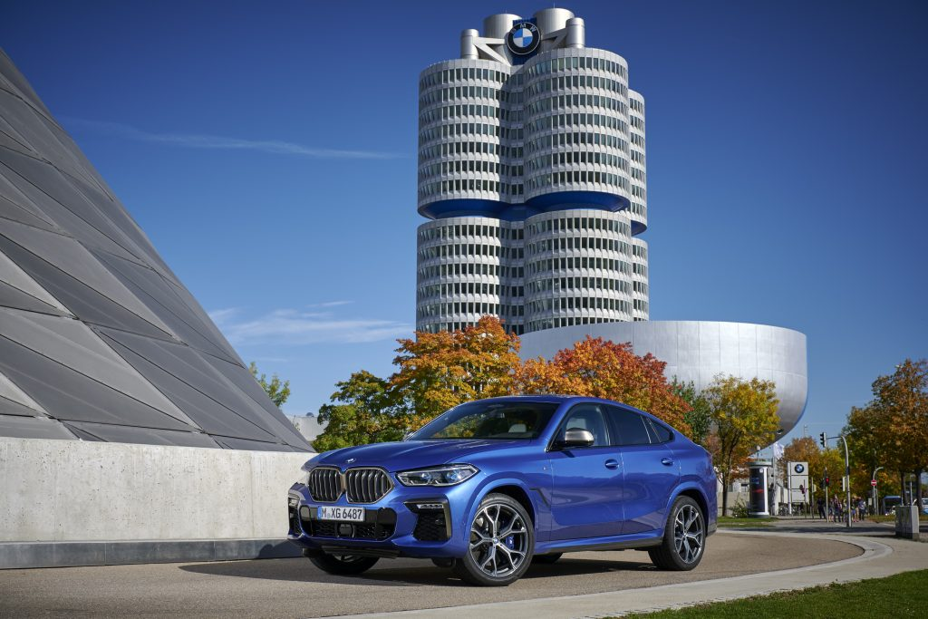 The BMW X5 M50i in blue outside the brand's factory