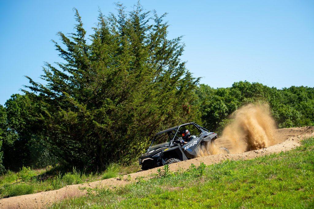 Polaris RZR going through a dirt burm