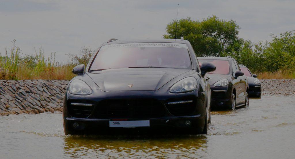 Three black Porsche Cayenne S SUVS.