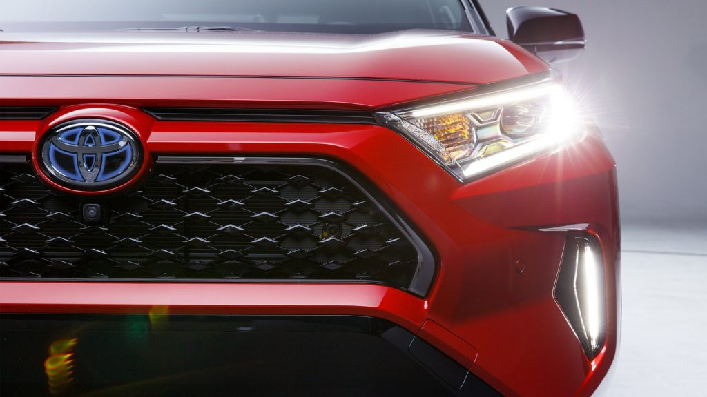 The front of a red 2021 Toyota Rav4.