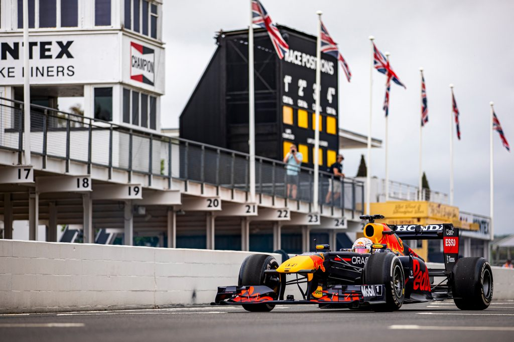 The RB7 car from Red Bull's F1 racing team parked on a race track.